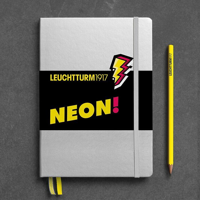 Notebook Medium (A5), Hardcover, 251 numbered pages, Silver & Neon Yellow. dotted
